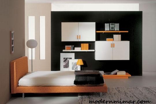 Modern olarak tasarlanmış genç erkek yatak odası dekorasyonu
